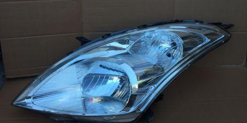2010- Suzuki Swift - Bal oldali első fényszóró Gyári! Fényszóró állító motorral. 25000Ft